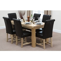 Image of: Chunky 5ft x 2ft 6 Solid Oak Dining Table and 6 Braced Black Scroll Back Leather Chairs