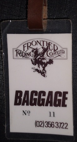 frontier booking tour baggage tag 1983