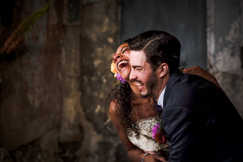 Bride and groom laughing at Asylum Chapel Wedding Peckham London