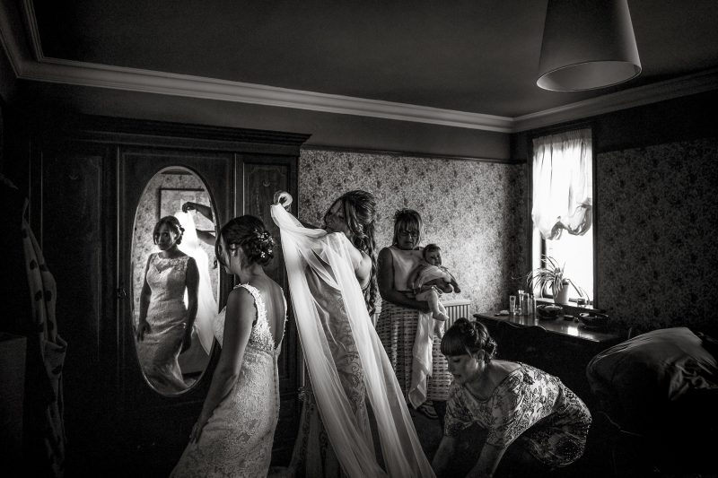 The Veil being put onto The bride on her wedding morning