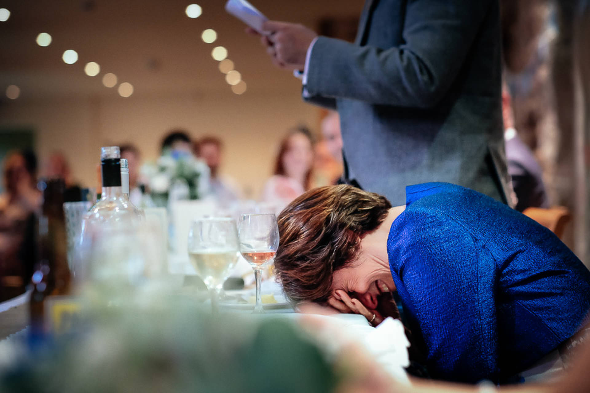 Embarrassed mother of the groom during wedding speeches