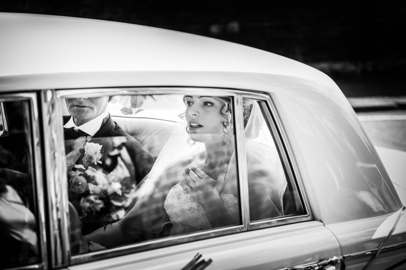Bride catches her breath as she arrives at church