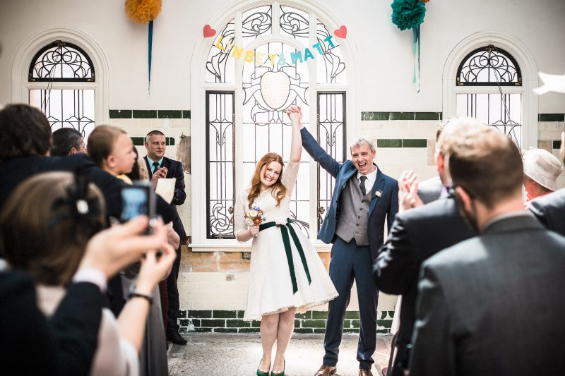 Bride and groom celebrate getting wed at a Victoria Baths Manchester wedding