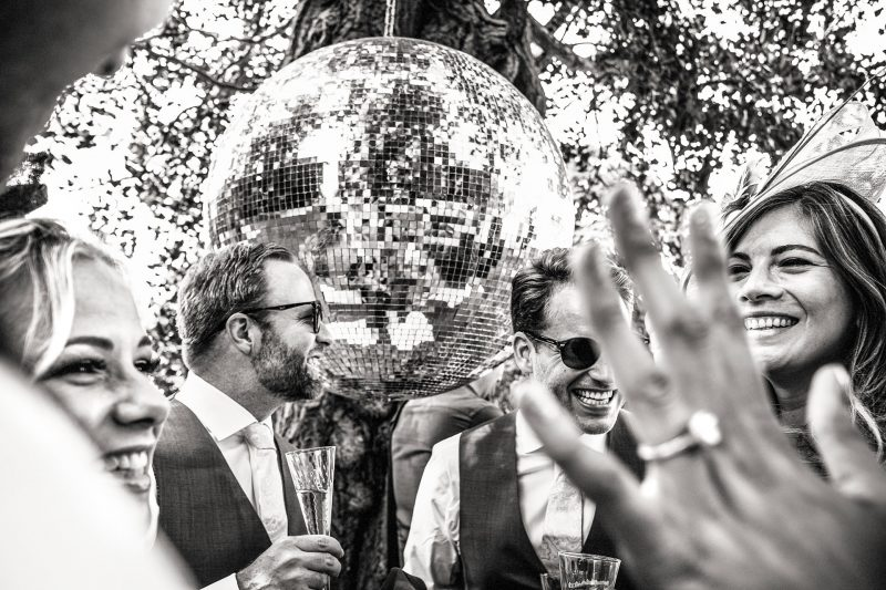 Guests laughing at a reception at an Aynhoe Park Wedding