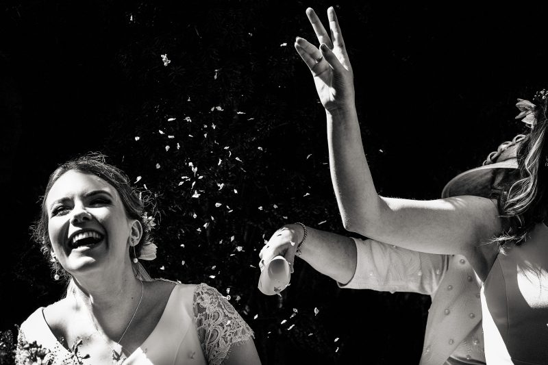 Black and white confetti throw with laughing bride