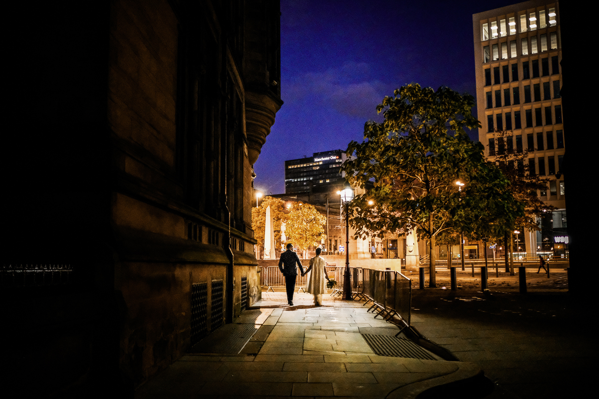 Bride and Groom walking at a Manchester City Centre wedding