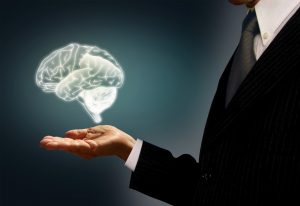 stockvault-businessman-holding-a-virtual-brain-in-the-palm---skills-concept181165 - kopie