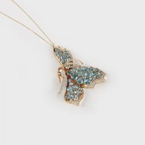 Grandioasă broşă din aur, decorată cu diamante şi topaze