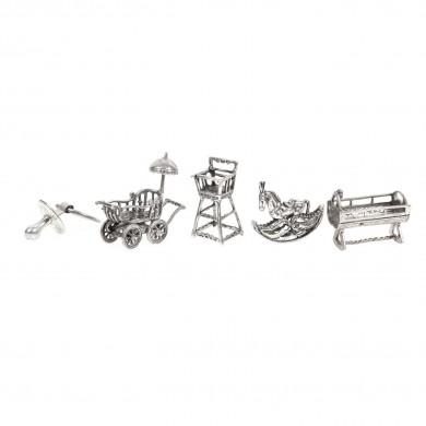 Colecție de miniaturi din argint, simboluri ale prunciei