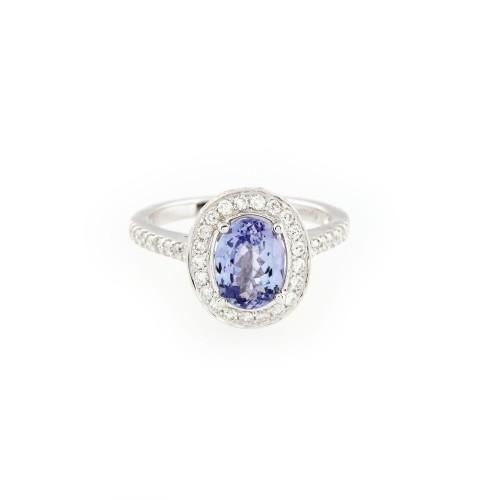 Inel din aur alb, ornat cu tanzanit anturat de diamante