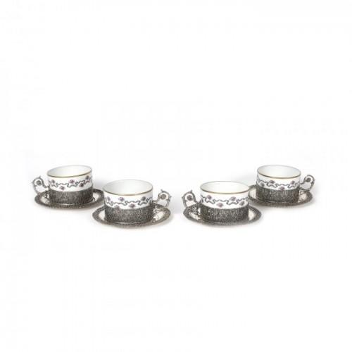 Set de patru ceșcuțe din porțelan Limoges, montate în argint traforat, pentru ceai [Sec. XX]