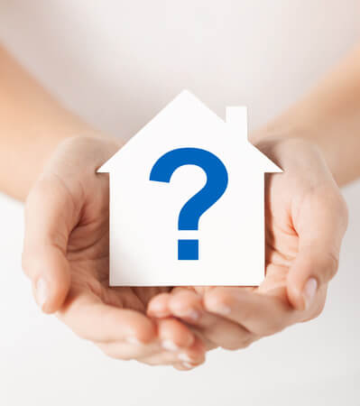26175621 - real estate and family home concept - hands holding paper house with question mark