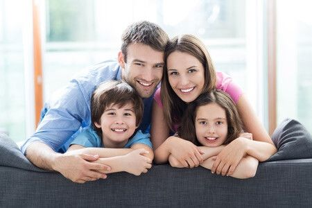 39944092 - family sitting on couch