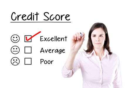 54753269 - hand putting the check mark with red marker on excellent credit score evaluation form.