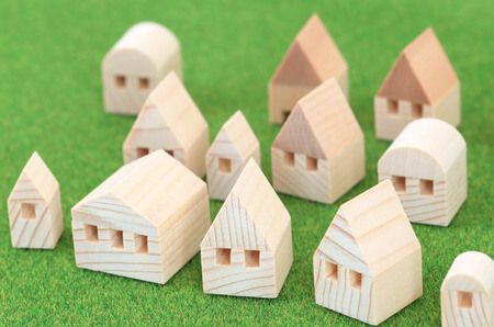 39237996 - miniature house on green background
