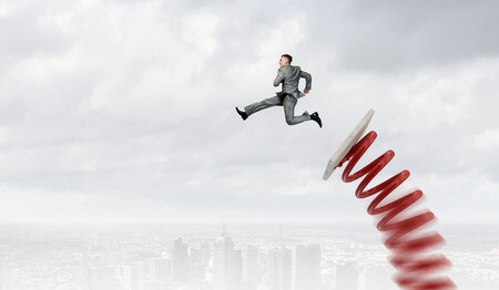 49538563 - businessman jumping on springboard as progress concept