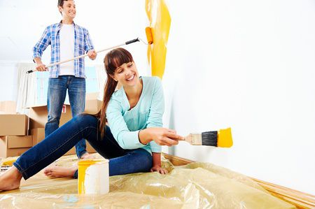 20863478 - renovation diy paint couple in new home painting wall