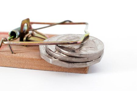 51431234 - money trap, loaded mousetrap with coins on white background