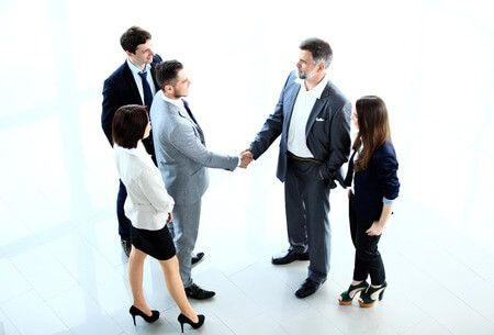 35868009 - top view of  business people shaking hands, finishing up a meeting - welcome to business