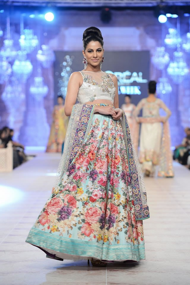 A gorgeous floral and mint bridal lehenga by Nomi Ansari