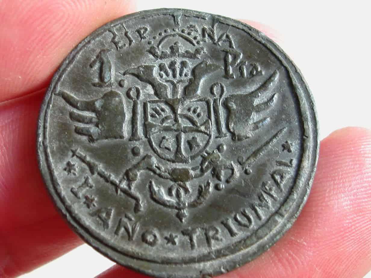 una peseta Moguer reverso