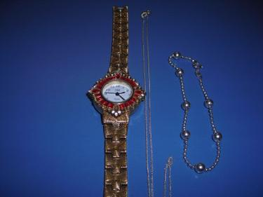 http://s3-eu-west-1.amazonaws.com/bumblebeeauction/201312/BRACELET CHAIN  WATCH.jpg
