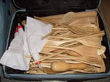 http://s3-eu-west-1.amazonaws.com/bumblebeeauction/201403/Suitcase full of various types of wooden spoons.jpg