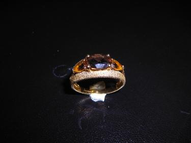 http://s3-eu-west-1.amazonaws.com/bumblebeeauction/201404/ym ring brown stones.jpg