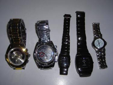 http://s3-eu-west-1.amazonaws.com/bumblebeeauction/201408/5 WATCHES.jpg