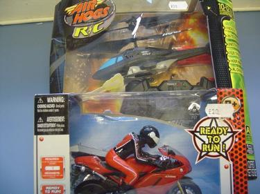 http://s3-eu-west-1.amazonaws.com/bumblebeeauction/201408/TOY REMOTE CONTROL HELICOPTER  MOTORCYCLE.jpg