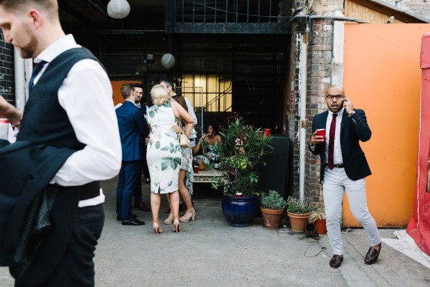 candid documentary wedding photography image at an urban and cool warehouse wedding venue in London