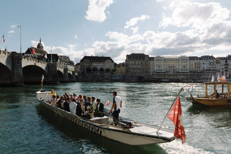 Wedding guests on a traditional Swiss boat on the Rhine river in Basel