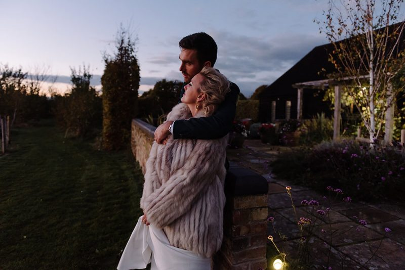 Photo of a beautify couple at sunset at South Farm wedding venue