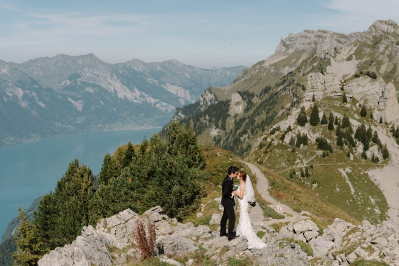 A couple hugs and enjoys a kiss in the mountains after their elopement in Switzerland