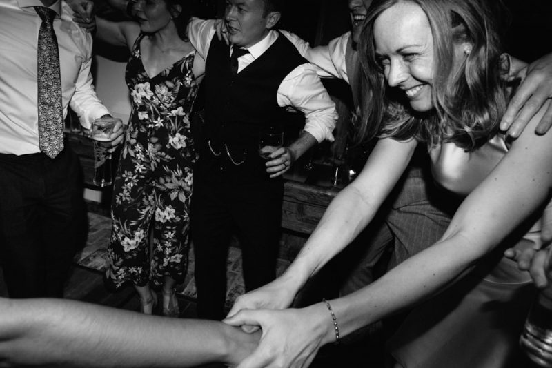 wedding guests dancing at an alternative wedding: photography by Caroline Hancox