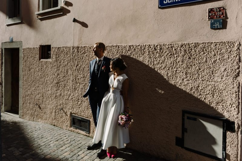 couple posing for a photo in Zurich old town on their wedding day