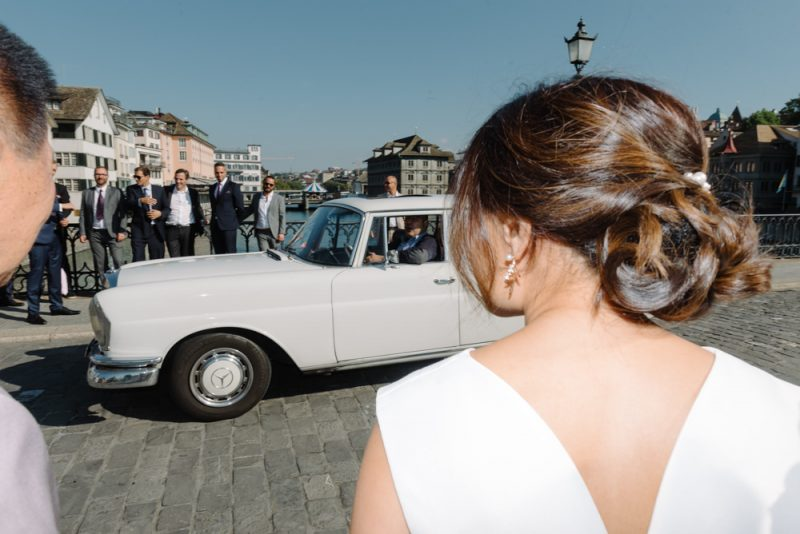 wedding photography scene a bride and a car in Zurich