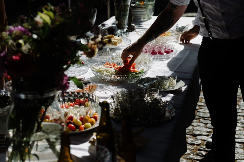 a hand is reaching for some canapés which hare all set out on a long table at Museum Kleines Klingental in Basel