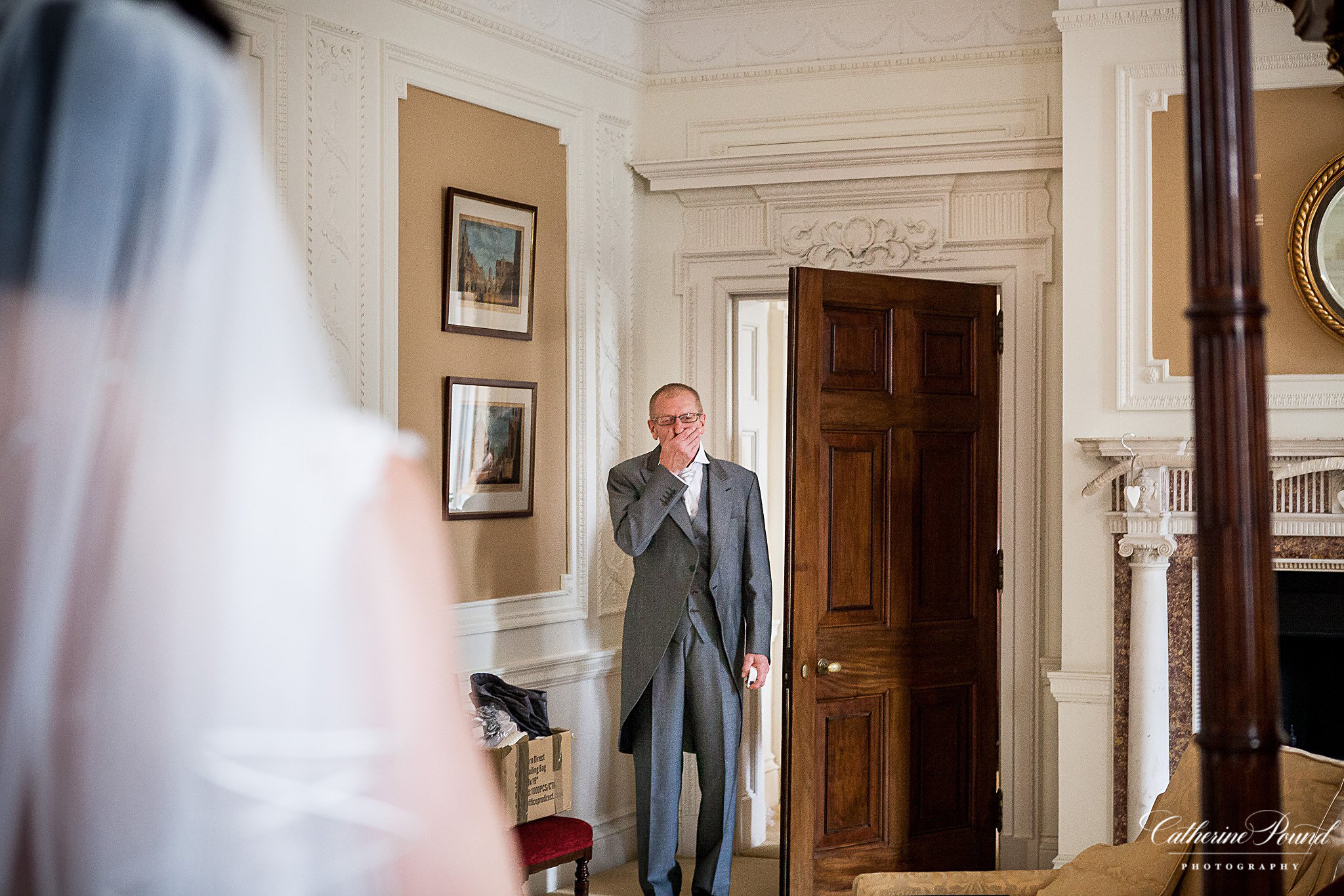 Father of the bride sees his daughter in wedding dress