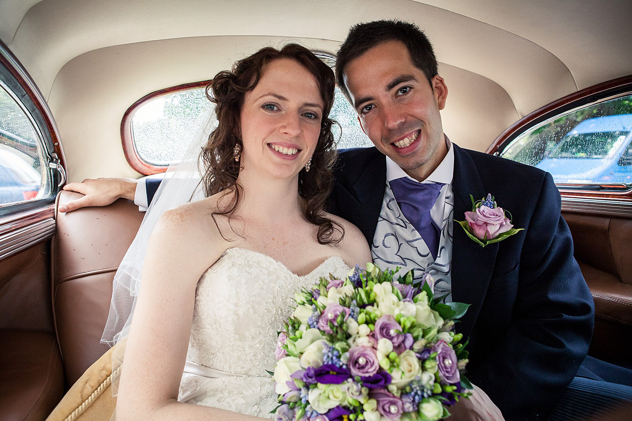 Couple in wedding car