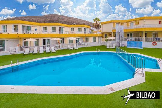 Aprovecha esta oferta para disfrutar de Tenerife Sur ¡Incluye avión desde Bilbao + 7 noches en el hotel Checkin Bungalows Atlantida con media pensión!