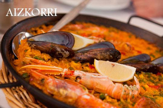 Menú en el Restaurante Aizkorri con arroz marinero, entrantes, postre y bebida ¡Disfruta de estas delicias gastronómicas tradicionales!