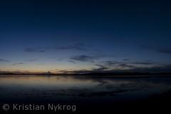 Billedet er taget i Kattinge Vig fra Boserup Skov med udsigt mod solnedgangen.