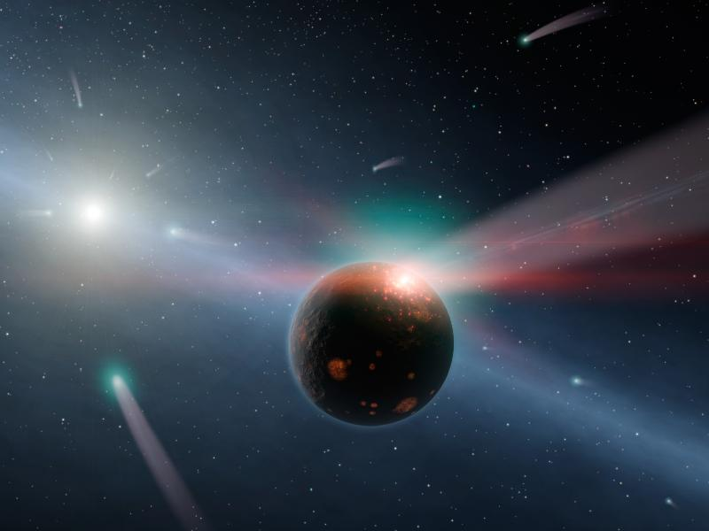 This artist's conception illustrates a storm of comets around a star near our own, called Eta Corvi. Image credit: NASA/JPL-Caltech