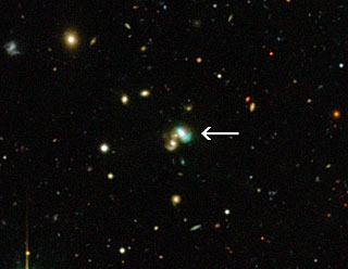 A view of newly-discovered Green Bean galaxy J2240. J2240 lies in the constellation of Aquarius (The Water Bearer) and is about 3.7 billion light years from Earth. Image Credit: CFHT/ESO/M. Schirmer