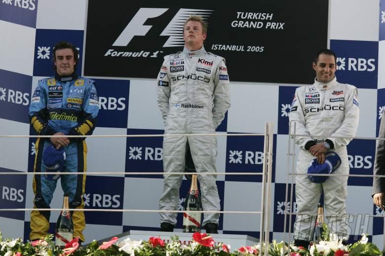Turkish GP winner, Kimi Raikkonen on the podium with Fernando Alonso [2nd] and Juan Montoya [3rd]