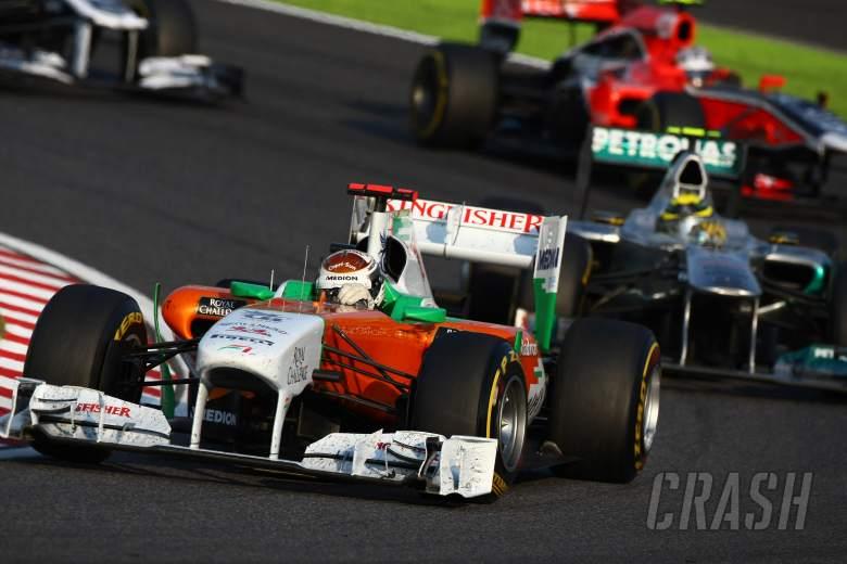 09.10.2011- Race, Adrian Sutil (GER), Force India F1 Team, VJM04 leads Nico Rosberg (GER), Mercedes