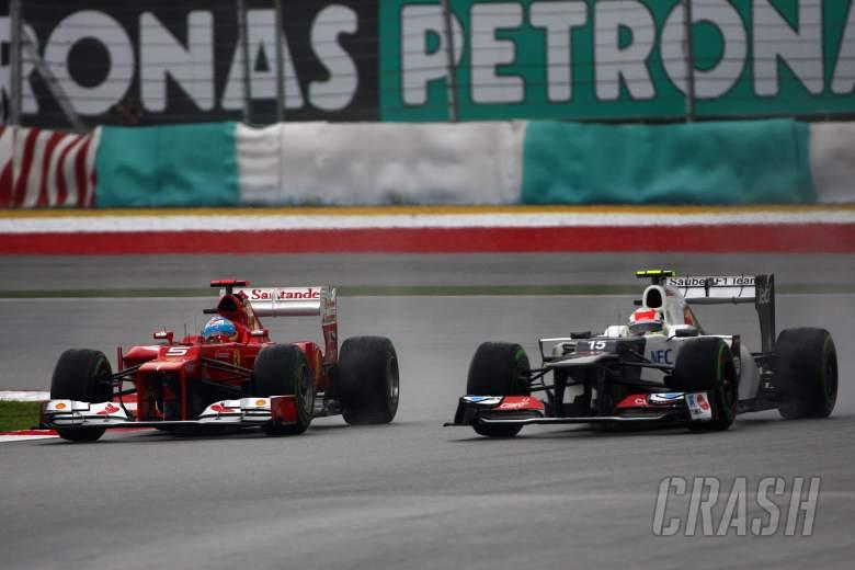 ,  - 25.03.2012- Race, Fernando Alonso (ESP) Scuderia Ferrari F2012 and Sergio PŽrez (MEX) Sauber F1 Team