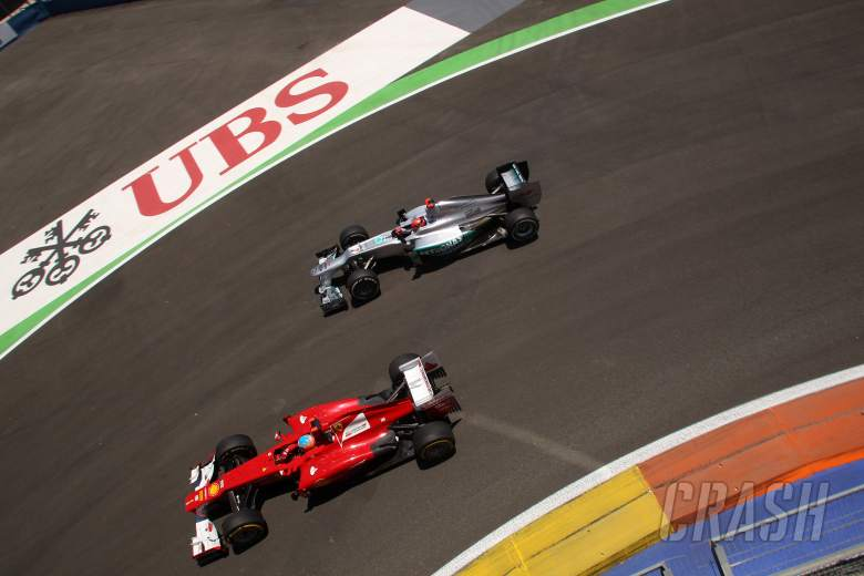 24.06.2012- Race, Fernando Alonso (ESP) Scuderia Ferrari F2012 and Michael Schumacher (GER) Mercedes