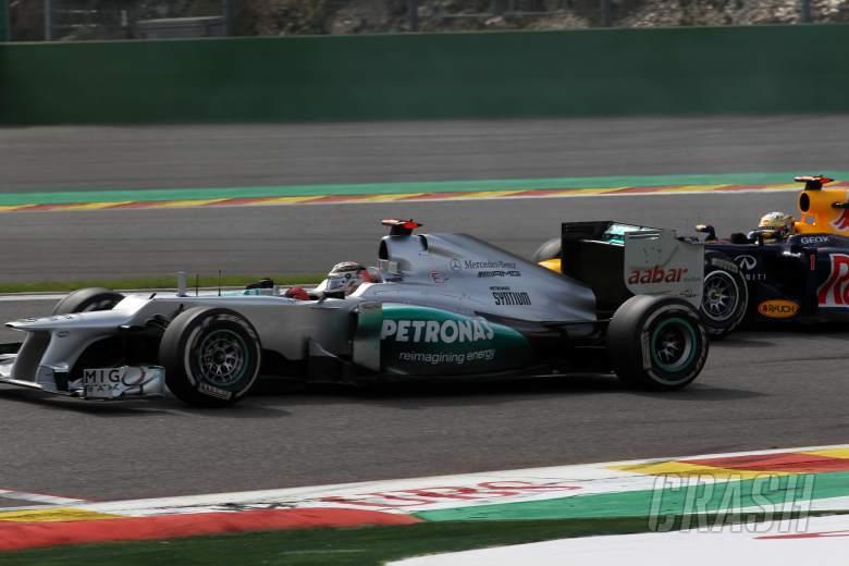 02.09.2012- Race, Michael Schumacher (GER) Mercedes AMG F1 W03 and Sebastian Vettel (GER) Red Bull R